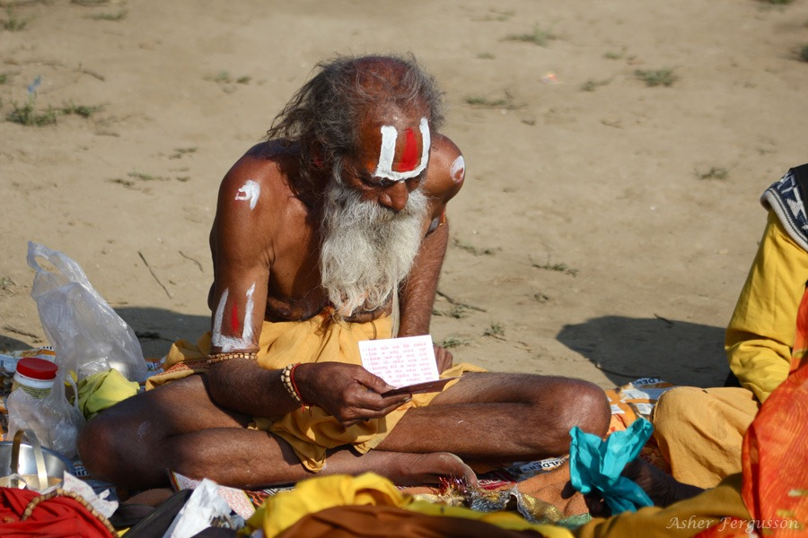 Reading the Vedas - Kumbha Mela, India