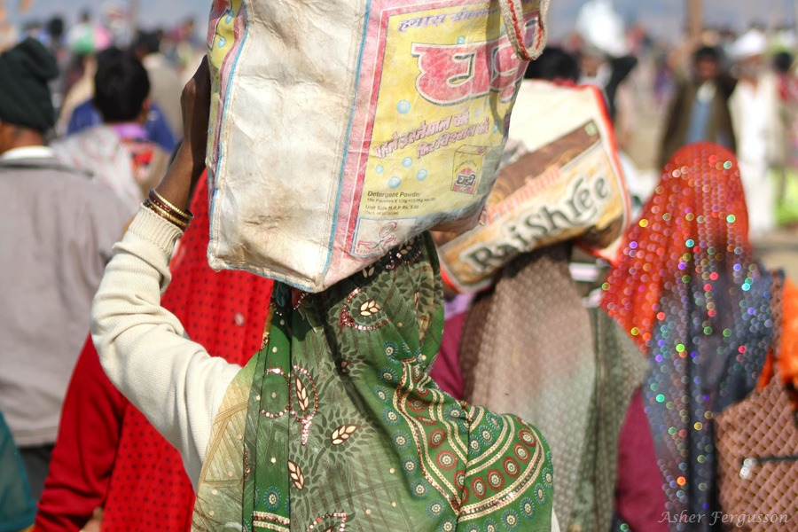 Indian Woman carrying bag on head