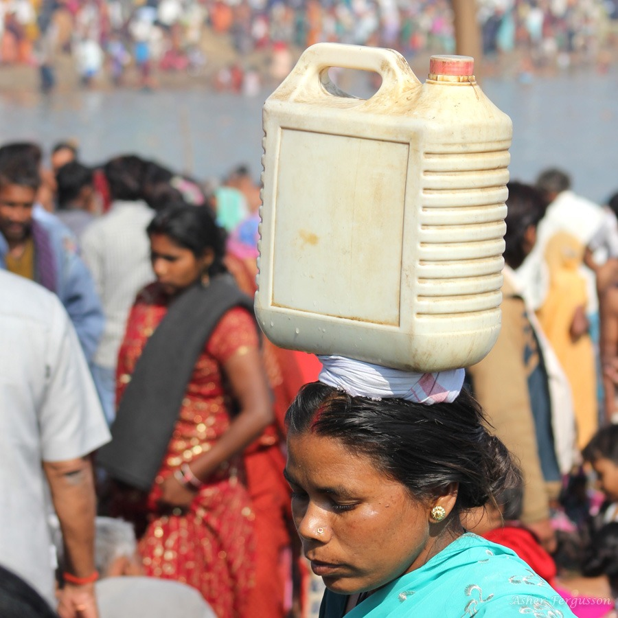 Carrying Ganges water on the head