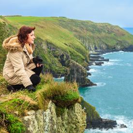 woman on Ireland cliff